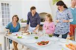 Family having breakfast at the dining table Stock Photo - Premium Royalty-Free, Artist: Cultura RM, Code: 6108-05866344
