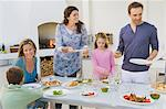 Family having breakfast at the dining table Stock Photo - Premium Royalty-Free, Artist: Yvonne Duivenvoorden, Code: 6108-05866359