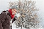 Young man about to throw a snowball Stock Photo - Premium Royalty-Free, Artist: Beyond Fotomedia, Code: 6108-05866831