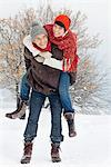 Young man giving his girlfriend piggyback in snow Stock Photo - Premium Royalty-Free, Artist: Robert Harding Images, Code: 6108-05866999