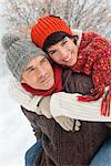 Young man giving his girlfriend piggyback in snow Stock Photo - Premium Royalty-Free, Artist: AWL Images, Code: 6108-05867058