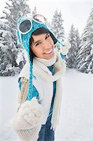 Young woman in winter clothes smiling at camera Stock Photo - Premium Royalty-Freenull, Code: 6108-05867072