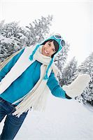 Young woman in winter clothes smiling at camera Stock Photo - Premium Royalty-Freenull, Code: 6108-05867132