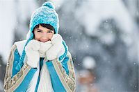 Young woman in winter clothes smiling at camera Stock Photo - Premium Royalty-Freenull, Code: 6108-05867139