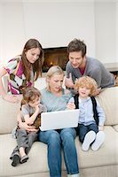 Family using a laptop Stock Photo - Premium Royalty-Freenull, Code: 6108-05867372