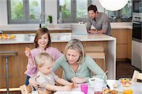 preteen kissing - Family at a breakfast table Stock Photo - Premium Royalty-Freenull, Code: 6108-05867391