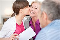 preteen kissing - Girl kissing her grandmother with her grandfather sitting beside them Stock Photo - Premium Royalty-Freenull, Code: 6108-05867567