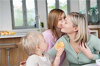Family at a breakfast table Stock Photo - Premium Royalty-Freenull, Code: 6108-05867606