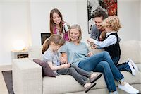 Family in a living room Stock Photo - Premium Royalty-Freenull, Code: 6108-05867665