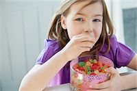 Portrait of a girl eating gum drops Stock Photo - Premium Royalty-Freenull, Code: 6108-05867682