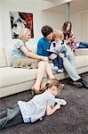 Family in a living room Stock Photo - Premium Royalty-Free, Artist: R. Ian Lloyd, Code: 6108-05867688
