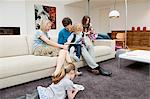 Family in a living room Stock Photo - Premium Royalty-Free, Artist: Blend Images, Code: 6108-05867691