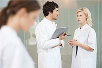 Two doctors discussing each other Stock Photo - Premium Royalty-Freenull, Code: 6108-05867906