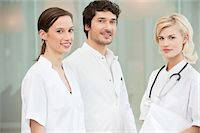 Portrait of three doctors smiling Stock Photo - Premium Royalty-Freenull, Code: 6108-05867933
