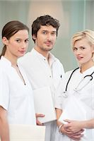 Portrait of three doctors smiling Stock Photo - Premium Royalty-Freenull, Code: 6108-05867956