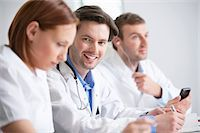 Portrait of a male doctor smiling Stock Photo - Premium Royalty-Freenull, Code: 6108-05867971