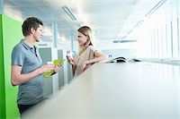 Business executives in an office during a coffee break Stock Photo - Premium Royalty-Freenull, Code: 6108-05868212