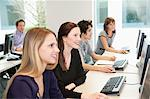 Business executives working on computers in a training class Stock Photo - Premium Royalty-Freenull, Code: 6108-05868555