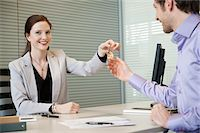 Female real estate agent giving house keys to a man Stock Photo - Premium Royalty-Freenull, Code: 6108-05868670