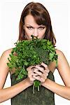 Young woman holding fresh herbs Stock Photo - Premium Royalty-Free, Artist: Photocuisine, Code: 6108-05869138