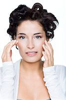 Young woman with hair clips Stock Photo - Premium Royalty-Freenull, Code: 6108-05869366