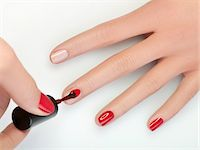 finger painting - Woman painting fingernails, close-up Stock Photo - Premium Royalty-Freenull, Code: 6108-05869440
