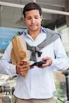Mid adult man checking the empty wallet with paper bag full of vegetables Stock Photo - Premium Royalty-Free, Artist: Aurora Photos, Code: 6108-05869579