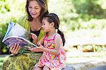 Woman with her granddaughter looking at a book Stock Photo - Premium Royalty-Free, Artist: Science Faction, Code: 6108-05870140