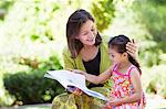 Woman with her granddaughter reading a book Stock Photo - Premium Royalty-Free, Artist: Robert Harding Images, Code: 6108-05870170