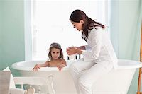 Woman giving a bath to her daughter Stock Photo - Premium Royalty-Freenull, Code: 6108-05870188