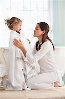 Woman wrapping her daughter in towel after the bath Stock Photo - Premium Royalty-Freenull, Code: 6108-05870191