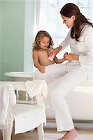 Woman giving a bath to her daughter Stock Photo - Premium Royalty-Freenull, Code: 6108-05870214