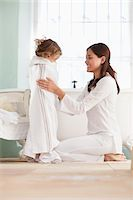 Woman wrapping her daughter in towel after the bath Stock Photo - Premium Royalty-Freenull, Code: 6108-05870234