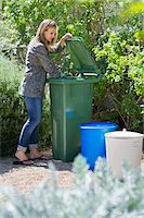 Woman looking into recycling bin Stock Photo - Premium Royalty-Freenull, Code: 6108-05870284