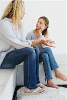 preteen beauty - Mid adult woman communicating with her daughter Stock Photo - Premium Royalty-Freenull, Code: 6108-05870359