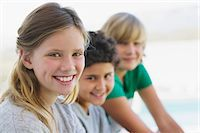 Portrait of a girl smiling with her two brothers Stock Photo - Premium Royalty-Freenull, Code: 6108-05870561