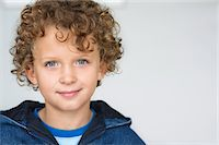 Portrait of a smiling boy Stock Photo - Premium Royalty-Freenull, Code: 6108-05870568