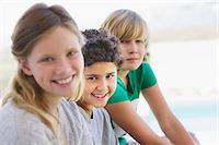 Portrait of a girl smiling with her two brothers Stock Photo - Premium Royalty-Freenull, Code: 6108-05870600