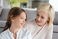 Woman looking at daughter and smiling Stock Photo - Premium Royalty-Freenull, Code: 6108-05871207