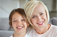 Portrait of a woman smiling with her daughter Stock Photo - Premium Royalty-Freenull, Code: 6108-05871217
