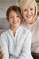 Portrait of a woman smiling with her daughter Stock Photo - Premium Royalty-Freenull, Code: 6108-05871229