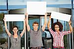 Portrait of three friends protesting with blank placards Stock Photo - Premium Royalty-Free, Artist: RelaXimages, Code: 6108-05871306