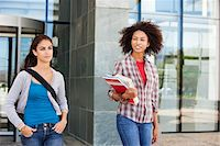 Two female friends walking in campus Stock Photo - Premium Royalty-Freenull, Code: 6108-05871336