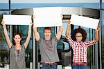 Angry friends protesting with blank placards Stock Photo - Premium Royalty-Free, Artist: CulturaRM, Code: 6108-05871339