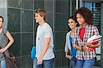 Smiling university students walking in campus Stock Photo - Premium Royalty-Freenull, Code: 6108-05871345