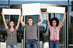 Three friends protesting with blank placards Stock Photo - Premium Royalty-Free, Artist: Oriental Touch, Code: 6108-05871355