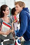 Man and woman having a discussion and smiling Stock Photo - Premium Royalty-Free, Artist: Cultura RM, Code: 6108-05871366