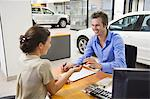 Young woman handing car key to a man Stock Photo - Premium Royalty-Freenull, Code: 6108-05871408