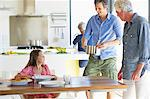 Multi-generation family eating food at home Stock Photo - Premium Royalty-Free, Artist: Robert Harding Images, Code: 6108-05871519