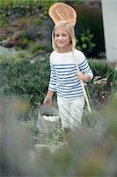 Girl carrying net and bucket for fishing Stock Photo - Premium Royalty-Freenull, Code: 6108-05871570